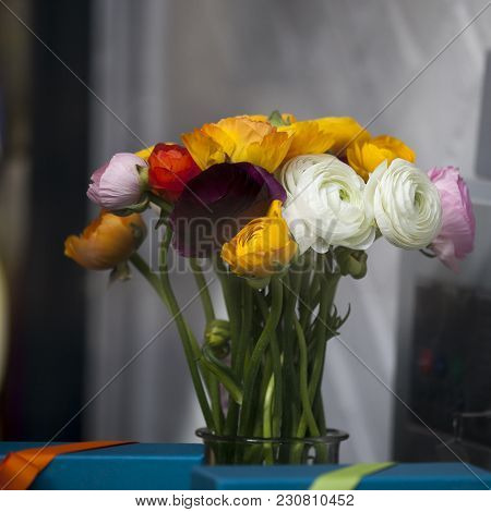 The Bouquet Of Orange And White Ranunculus
