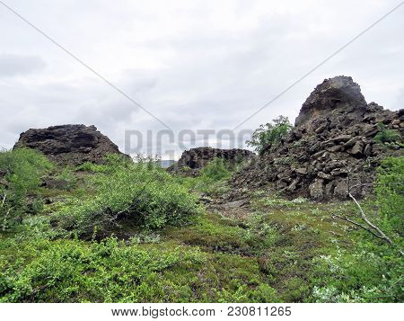 The Landscape Of Dimmuborgir Area With Volcanic Caves And Rock Formations In Northeast Iceland, July