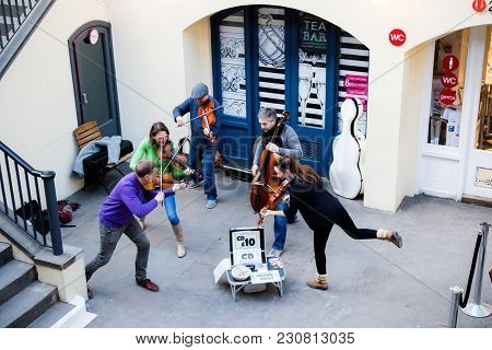 London, United Kingdom, 7th March 2018:-a Street Performance In Covent Garden Of A String Quintet Bu