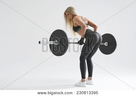 Photo Of Confident Young Woman Doing Weight Lifting Workout At Gym Turning Back Attractive Young Wom