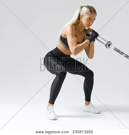 Close-up Photo Of Hamstring, Quad And Booty Workout Attractive Fitness Model Workout With Barbell Ro