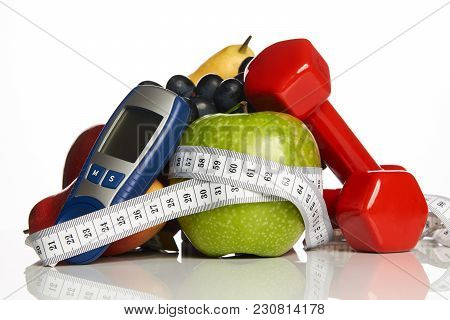 Blood Sugar Control Glucometer For Glucose Level With Healthy Organic Food And Dumbbells With Measur