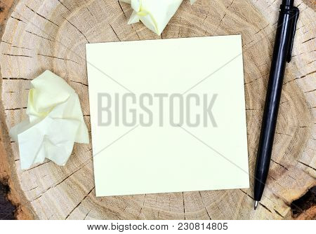 Empty Sticky Note Paper With Pen On Wood Table