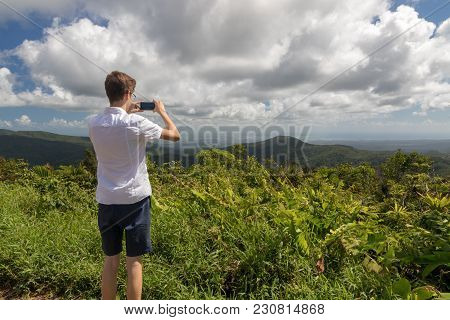 Teenager Taking Picture Of A Tropical Landscape In Guadeloupe, Caribbean. Morne A Louis Viewpoint To
