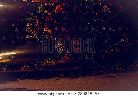 Abstract Background With Luminous Multicolored Stars On A Dark Background For Postcards