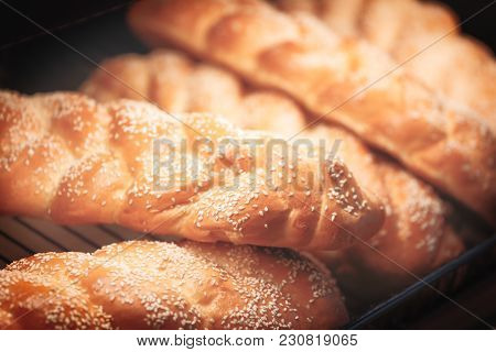 Fresh Fragrant Bread On The Table. Food Concept