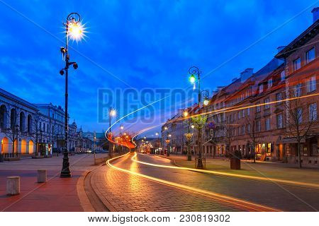 Krakowskie Przedmiescie Street, Part Of The Royal Route In Old Town During Evening Blue Hour, Warsaw
