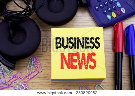 Word, Writing Business News. Business Concept For Modern Online News Written On Sticky Note Paper On