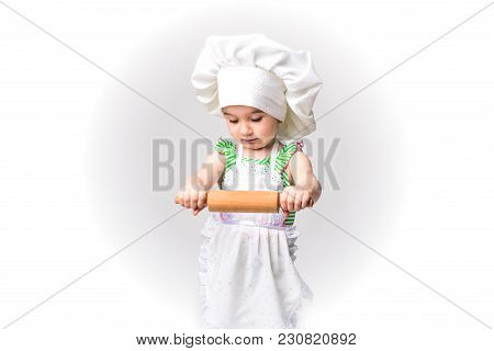 Cook - Little Girl On A Light Background With A Rolling Pin.