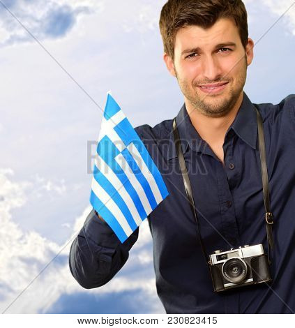 Photographer Holding Greece Flag, Outdoor
