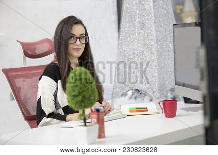 Young Woman Using Tablet Computer Through The Window In Office.