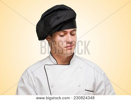 Portrait Of A Handsome Chef against a beige background
