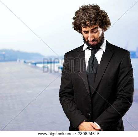 Portrait Of An Unhappy Businessman at a port