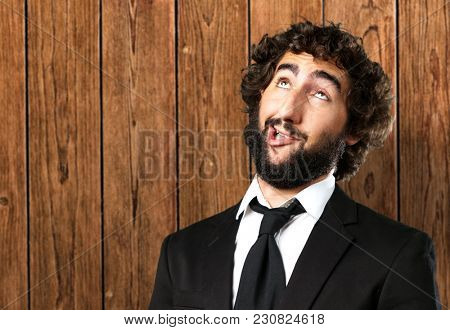 Portrait Of An Unhappy Man against a wooden background