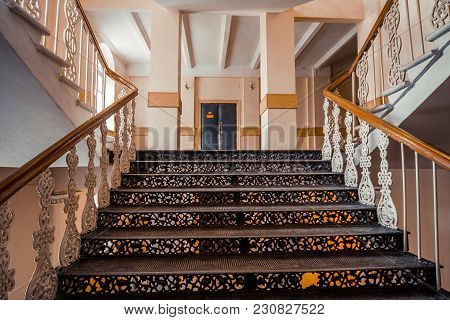 Iron Beautiful Vintage Stairs In The Old Mansion. Ornate Handrail Of Wrought Iron.