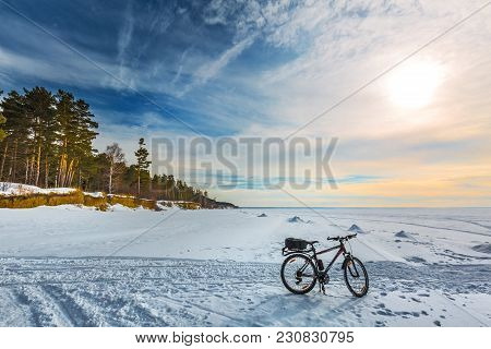 Ob, Novosibirsk Region, Western Siberia, Russia - March 10, 2018: Winter Bicycle On The Ice Of The O