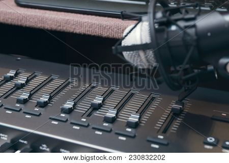 Microphone and multi-channel mixer at radio station