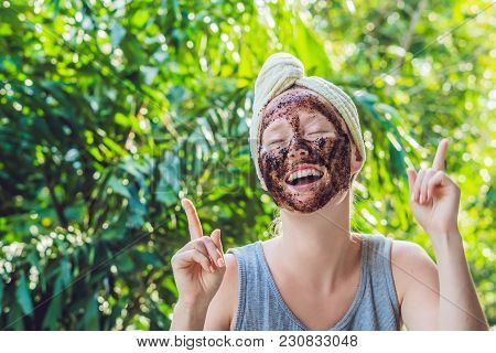 Face Skin Scrub. Portrait Of Sexy Smiling Female Model Applying Natural Coffee Mask, Face Scrub On F