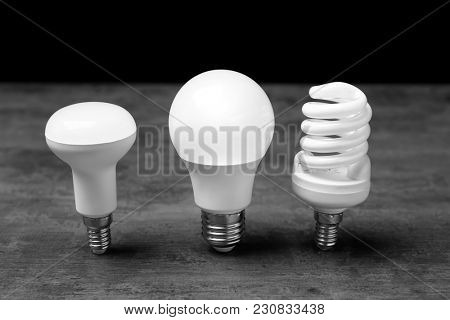 LED and fluorescent lamps on table