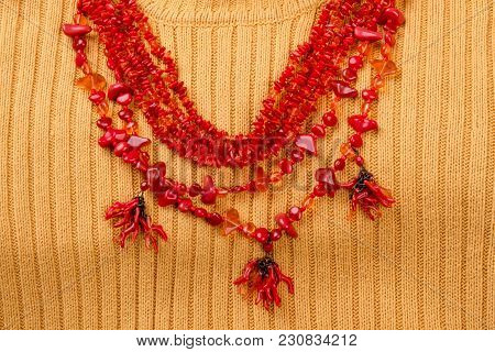 Statement Red Coral Necklace. Yellow Wool Background.