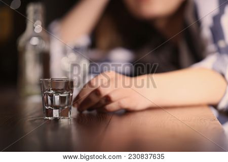 Woman with glass of alcohol in bar