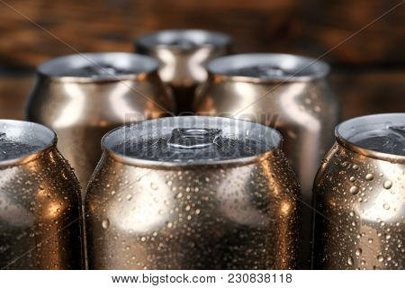 Cans of beer on blurred background, closeup