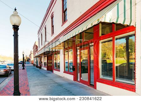 A side view of old downtown storefronts with lampposts in Garner, North Carolina.