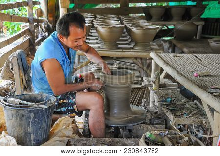 Sukhothai, Thailand - July 10, 2011: Senior Craftsman Making Pottery From Clay By Using Electrical M