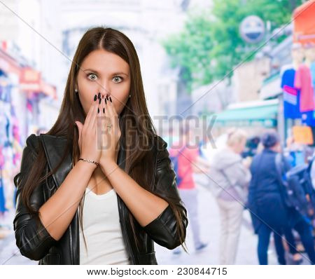 Surprised Woman covering her mouth at a market, outdoor