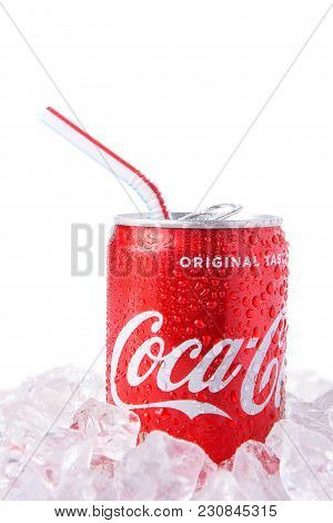 Irvine, California - March 12, 2018: A Can Of Coca-cola With Drinking Straw On Ice. Coca-cola Is The