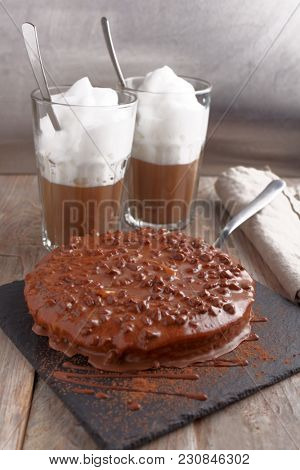 Swedish almond cake with dark chocolate and coffee latte