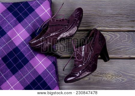 Close Up Purple Shiny Heel Shoes. Violet Checkered Clothing.