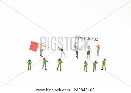 Figure Of Pedestrians, Demonstrators And Onlookers Walking Along