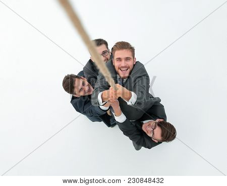 business team helping the Director to climb the rope.