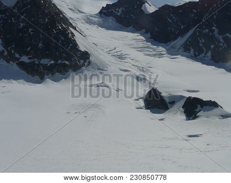 View Of A Rocky Outcrop Showing Through A Glacier On Mount Mckinley In Alaska