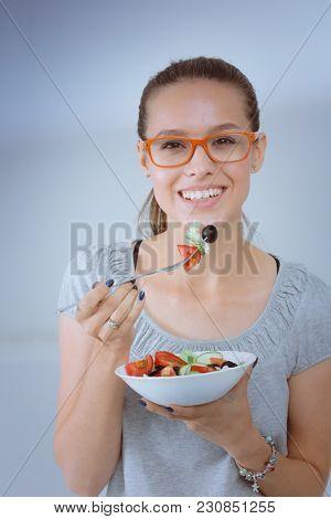 A beautiful girl eating healthy food. Beautiful girl