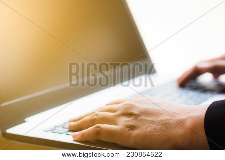 Business Hand Using Laptop For Working. Hand Use Laptop Checking E-mail Or Message. Close Up Hand Of