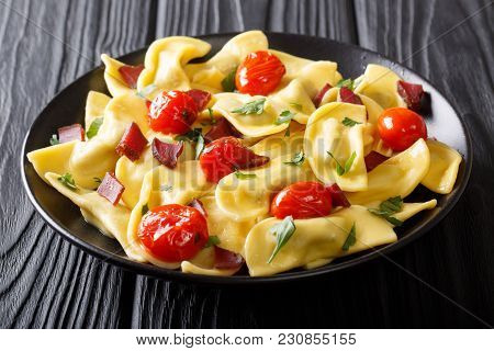 Italian Dumplings Casoncelli With Ham Prosciutto, Cherry Tomatoes And Greens Close-up. Horizontal