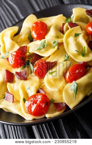 Delicious Italian Pasta Casoncelli With Ham Stuffing, With Cherry Tomatoes Close-up On A Plate. Vert