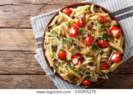 Penne Pasta With Fried Mushrooms, Tomatoes, Pepper And Cheese Close-up. Horizontal Top View