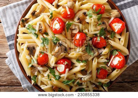 Italian Penne Pasta With Fried Mushrooms, Tomatoes, Pepper And Parmesan Close-up. Horizontal Top Vie