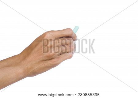 Hand Holding Green Chalk Writing Something Text On Empty Space. Isolated On White Background With Cl