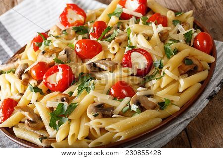 Italian Food: Penne Pasta With Mushrooms, Cherry Tomatoes, Stuffed Peppers Close-up. Horizontal