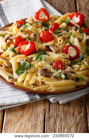 Italian Penne Pasta With Fried Mushrooms, Tomatoes, Pepper And Parmesan Close-up. Vertica