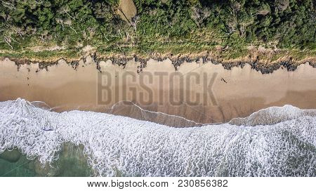 Beautiful Waves Coming Into Shore At Bonny Hills Beach From Above