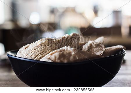 Boiled Chicken Breast In A Black Cup On A Wooden Table. Boiled Chicken Breast With High Protein Cont