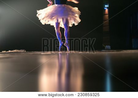 Blurred Legs Of Ballet Dancer On Stage In Theater