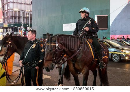 New York, United States Of America - November 20, 2016: Police Officers On Horseback At Times Square