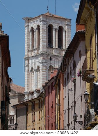 FERRARA, ITALY - JUNE 17, 2017: Bell tower of St. George Cathedral viewed from Via Giuseppe Mazzini. The bell tower built in XV century by design of Leon Battista Alberti