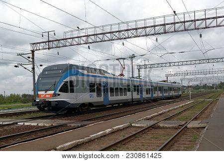 GORODEYA, BELARUS - AUGUST 27, 2012: Modern commuter train of Belarussian railways. It is one of four trains produced by Stadler Rail AG, Switzerland for Belarus in 2011-2012